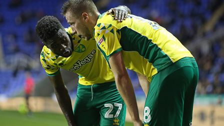 Alex Tettey speaks to Marco Stiepermann - this time after his run created the winning goal at Readin