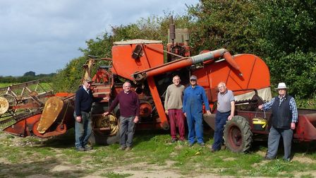 Organisers of the Skeyton Michaelmas Trosh with an Allis-Chalmers Gleaner combine and an Internation