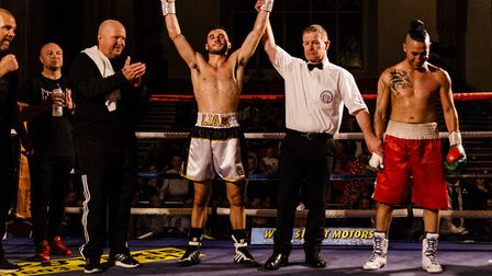 Liam Goddard celebrates victory after his pro boxing debut in Norwich Picture: Mark Hewlett