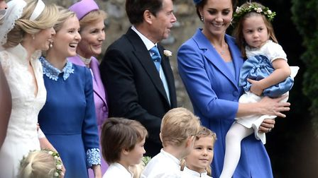 Princess Charlotte with her Godmother on her big day. The Duke and Duchess of Cambridge with Prince