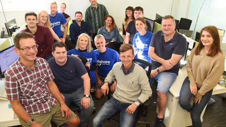 Ali Clabburn, front centre, founder and chief executive of Liftshare, with his team at their office