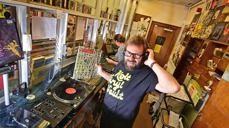 Andrew Worsdale, owner of Holt Vinyl Vault pictured when he was still also functioning as a Post Off