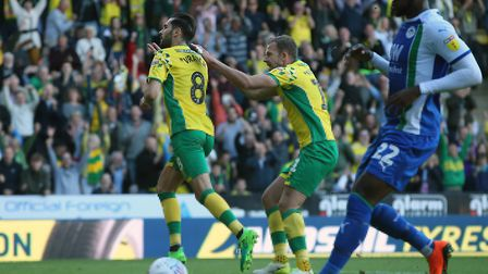 Mario Vrancic wheels away to celebrate scoring Norwich City's late winning penalty over Wigan Athlet