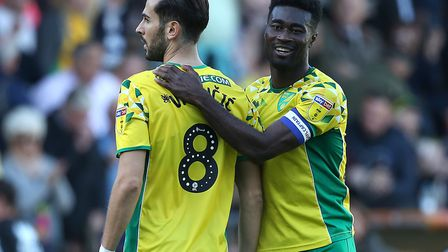 Alex Tettey, who was too nearvous to watch Mario Vrancic's penalty, congratulates Norwich City's mat