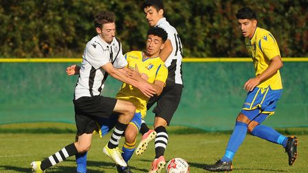 Action from Norwich United against Long Melford. Linton Garrod, 2nd left, and Harry Barker, right. P
