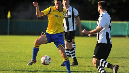 Action from Norwich United against Long Melford. Ben Jones for Norwich United. Picture: DENISE BRADL