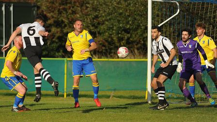 Goalmouth action from Norwich United against Long Melford. From left, Norwich United (yellow) player