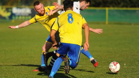 Action from Norwich United against Long Melford. Sam Applegate, left, and Harry Barker for Norwich U