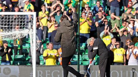 Norwich City head coach Daniel Farke salutes the Carrow Road faithful after victory over Wigan. Pict