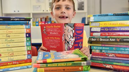 A youngster at Carleton Rode school delves into a book for the launch of our Books for Schools campa