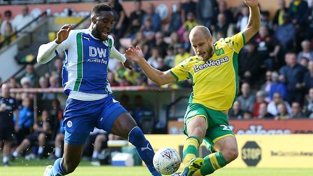Teemu Pukki is caught by Chey Dunkley during City's win over Wigan last weekend. Picture: Paul Chest