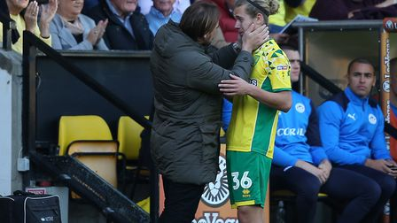 Norwich City head coach Daniel Farke checks in with Todd Cantwell, after replacing him in the second