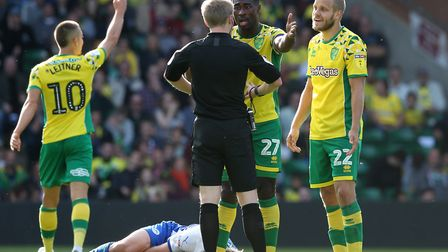 Alexander Tettey has a polite word with referee Gavin Ward during Norwich City's 1-0 Championship wi