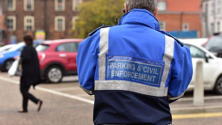 File image of a parking enforcement officer checking cars in Great Yarmouth PHOTO: Nick Butcher