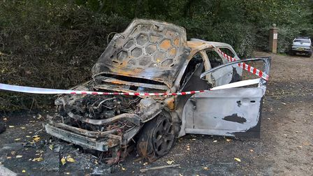 The burnt out car at St Peter and St Paul Church, Burgh Castle. Picture: Steve Griffiths