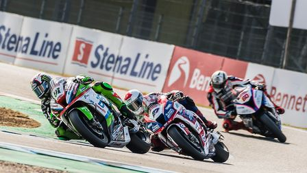 Leon Haslam out in front of Jake Dixon in Assen. Picture: Barry Clay