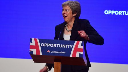 Prime minister Theresa May dances as she arrives on stage to make her speech at the Conservative Par