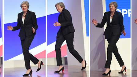 A composite picture of Prime Minister Theresa May dancing as she arrives on stage to make her keynot