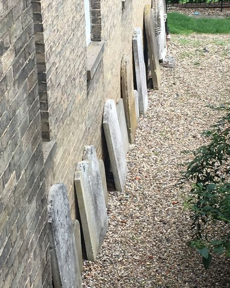 Headstones at the current Diss Baptist Church after being removed from the former burial ground in C