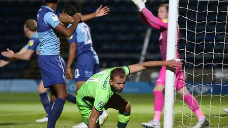 Wycombe players appeal in vain for handball as Jordan Rhodes turns away in triumph after opening the