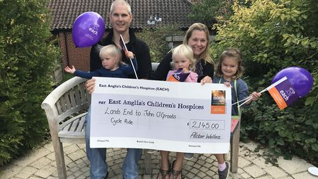 Alistair Wallace and his family with the cheque which was given to EACH. Picture: Supplied by EACH.
