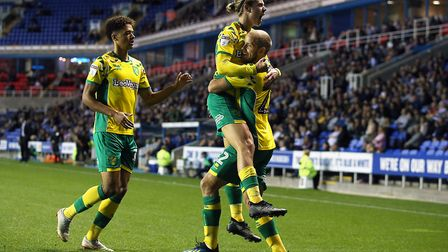 Teemu Pukki celebrates with Todd Cantwell after the Finn striker's fine first half strike at Reading