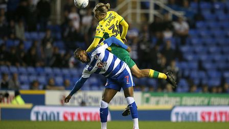 Leandro Bacuna of Reading and Todd Cantwell of Norwich in action during the Sky Bet Championship mat