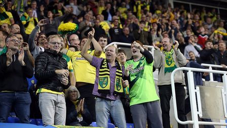 The traveling Norwich fans celebrate their side's 2nd goal during the Sky Bet Championship match at