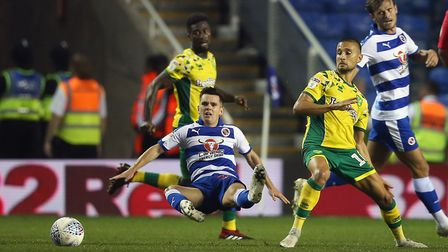 Liam Kelly of Reading and Moritz Leitner of Norwich in action during the Sky Bet Championship match