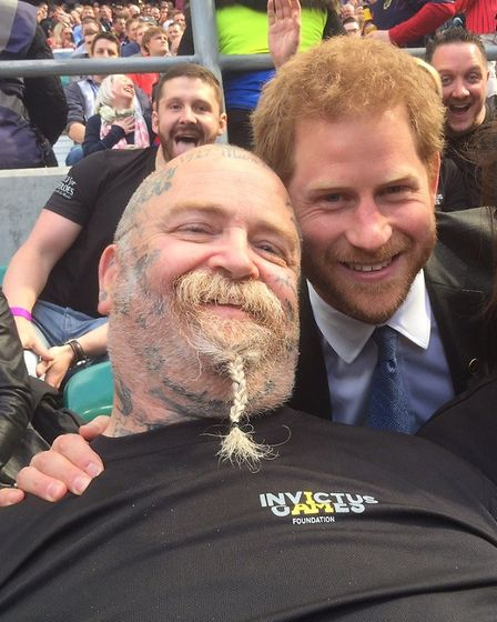 Paul Guest, from Frinton-on Sea, with Prince Harry Picture: HELP FOR HEROES