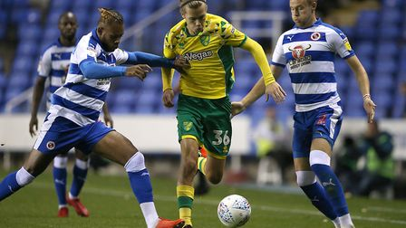 Todd Cantwell of Norwich, Chris Gunter of Reading and Leandro Bacuna of Reading in action during the