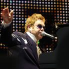 Elton John performing on the piano on stage at Carrow Road singing to thousands of people.Picture: J