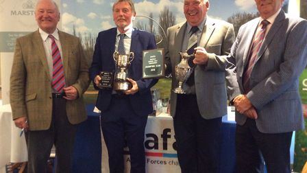 The winners of the annual SSAFA Norfolk tournament with their trophies at Bawburgh Golf Club. Pictur