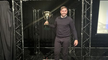 Grant Holt with the Crusher Mason Trophy. Picture: WAW