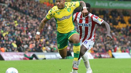Onel Hernandez of Norwich and Oghenekaro Etebo of Stoke City in action during the Sky Bet Championsh