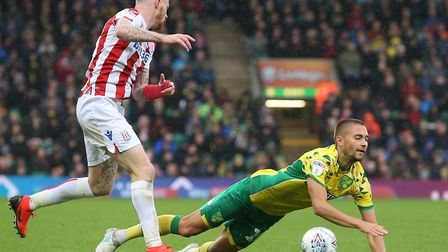 Norwich City playmaker Moritz Leitner is sent to the floor by Stoke's James McClean at Carrow Road.P