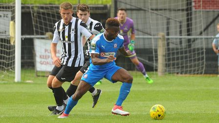 Dion Frary, left, was out of luck for Dereham Town Picture: DENISE BRADLEY
