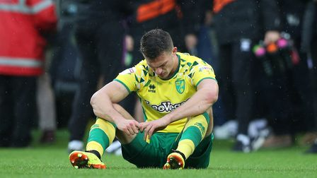 Christoph Zimmermann of Norwich looks dejected at the end of the Sky Bet Championship match at Carro