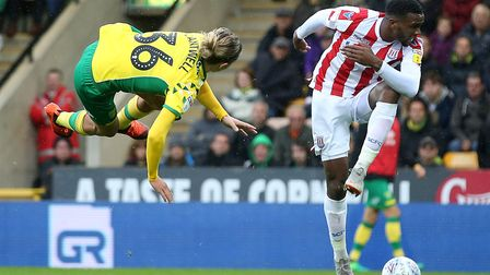 Todd Cantwell and Cuco Martina clash during Norwich City's home defeat to Stoke at Carrow Road. Pict