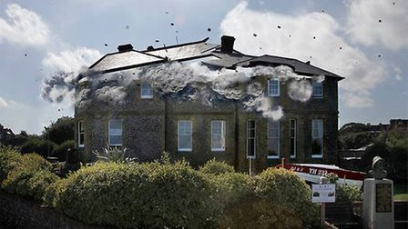 The roof of North Lodge Park being blown off, in an image created by Cromer photographer David Morri
