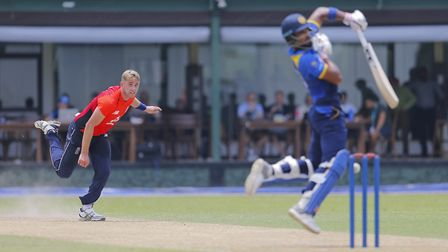 England's bowler Olly Stone delivers a rising delivery to Sri Lanka's Board XI batsman Dinesh Chandi