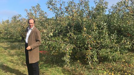 Andrew Jamieson with one of the first trees his father planted at Drove Orchards Picture: Drove Orc