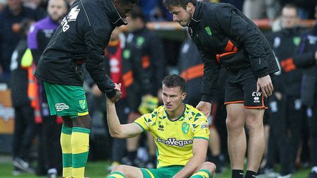 Christoph Zimmermann tries to digest the full-time whistle on the pitch at Carrow Road, as Norwich C