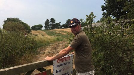 Neighbour Colin Mason at the land off Gimingham Road, Trimingham, which could be sold. Picture: Davi