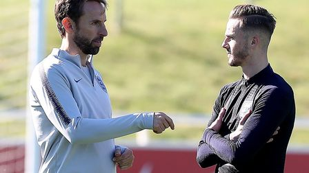 England manager Gareth Southgate (left) and James Maddison (right) during the training session at St