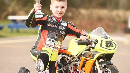 Mini-Moto racer Mason Foster (8) with one of the trophies he has won Picture: ARCHANT