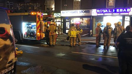 Firefighters at the scene of the fire at PJ's Takeaway in Northgate Street, Great Yarmouth.