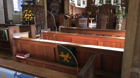 One of two 'There but no there' transparent seated military figure situated in the pews to symbolise