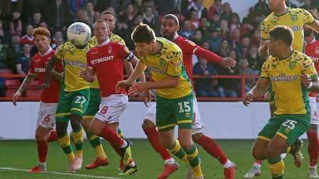 Timm Klose nods home Moritz Leitner's free-kick to earn the Canaries a draw at Nottingham Forest Pic
