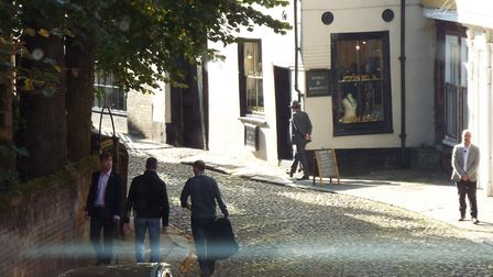 4pm: The bodyguard team secures the location around the shop - as a paparrazzi snaps pictures from a